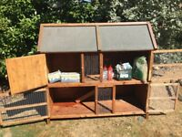 Two Tier Rabbit Hutch. Sawdust, Hay, Food and Water Bottles Inc.