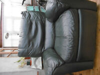 Leather soft chair with foot rest.