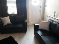 2 faux black leather sofas