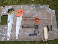 used wood saws and cartridge guns One paint roller not been used
