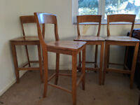 Four John Lewis beech wood bar stools