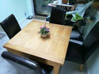Oak dining table with four free chairs