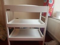 Baby changing station with two shelves.