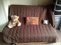 Double futon sofa bed with brown throw