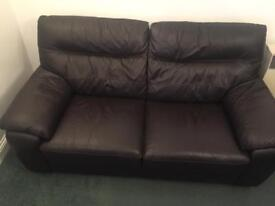Two 2 seater genuine leather sofas and a storage foot stool
