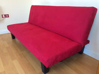 Red Wayfair 3 seater clic-clac sofa bed.