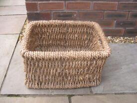 A wicker log basket.