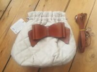 Bow white and brown handbag.
