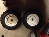 2 snowblower tires like new! On older rims!