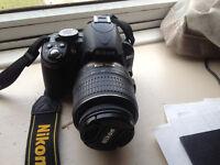 Nikon D3100 Digital SLR Camera with 18-55mm lense and case