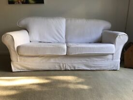 White sofa with washable covers and UK fire reg. label