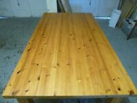 Large solid wood dining room table in good condition