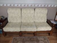Solid dark wood 3 seater sofa with 2 solid wood arm chairs