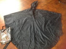Waterproof cape with hood for wheelchair user