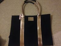 Victoria's Secret black and gold bag. Brand new with tags