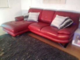 lovely red corner leather settee. well looked after . bought new for £1500 bargain at £300