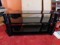 Television stand takes a 55 inch tv 55 kilos black in colour good condition