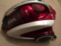Hoover Red 'Curver' Cylinder Vacuum Cleaner in good condition with attachments.