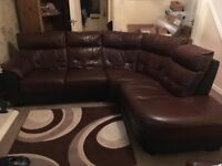 6 seater corner leather settee with reclining chair . No stratches or marks, excellent condition.