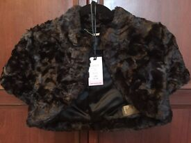 Ladies shrug/ cover up. From Coast. Black faux fur Size 10/12