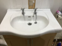 White Bathroom Washbasin with Victorian Taps and Supporting Cupboard and Tap Connections