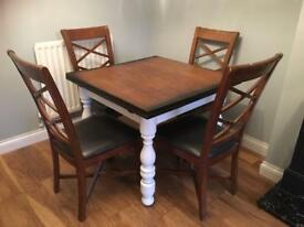Solid wooden extendable table with chairs . Burnt effect gorgeous .