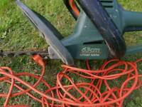 Black and Decker electric hedge trimmer.