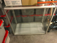 Glass display case with chrome edges