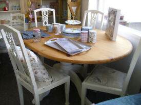 soild pine dining room table and four chairs