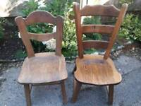 Two Oak or similar wood chairs. £10 for the large one. £7 for the other.