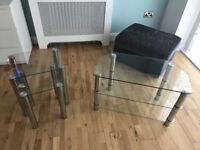 Glass nesting tables and tv stand. Good condtion, only 2 months old. Selling because changing decor.