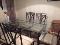Beautiful glass wrought Iron 6 Seater table and chairs