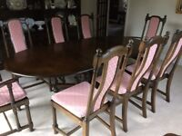 Ercol extending dining table and 8 chairs