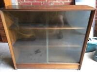 Small bookcase with sliding glass fronts.