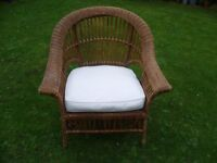Large rattan chair with upholstered cushion