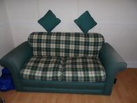 Sofabed still in good condition . Used with a springloaded bed