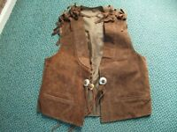 Vintage suede western style fringed waistcoats & a skirt.