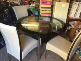 Glass table and faux leather chairs