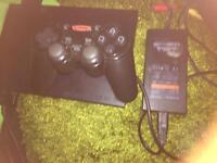 For sale one ps 2 slim plus games