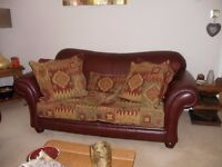 2 x 2 seater sofa's and chair in leather /chenille ,plus two foot stools & chenille curtains .