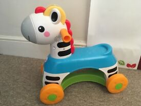 Fisher Price Musical Ride On Zebra