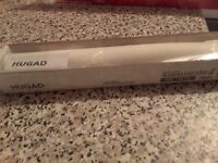 Two white ikea curtain rod corners for bay windows.