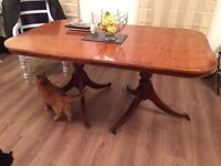 Dining table and 8 chairs with matching walnut sideboard available
