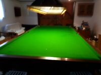 Quality full size slate based snooker table. Both table and cloth in good condition.
