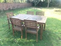 Wooden outdoor dining table and 5 chairs