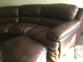 Brown leather sofa with foot stools