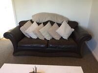 Dark brown leather/fabric sofa
