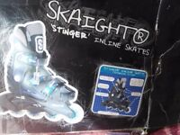 Boys Inline skates size 4.good condition,with box and knee pads.black/silver