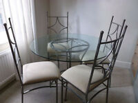 Beautiful Glass dining table and 4 chairs, can arrange free delivery