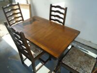DARK WOOD TABLE AND 4 CHAIRS at Haven Trust's charity shop